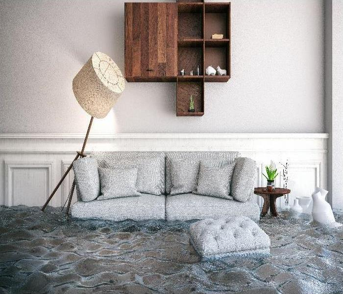 Flood in a house with furniture floating